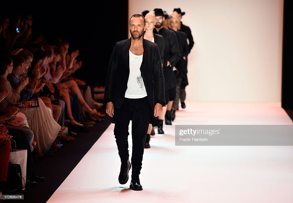 Models walk the runway at the Umasan Show during Mercedes-Benz Fashion Week Spring/Summer 2014 at Brandenburg Gate on July 5, 2013 in Berlin, Germany.