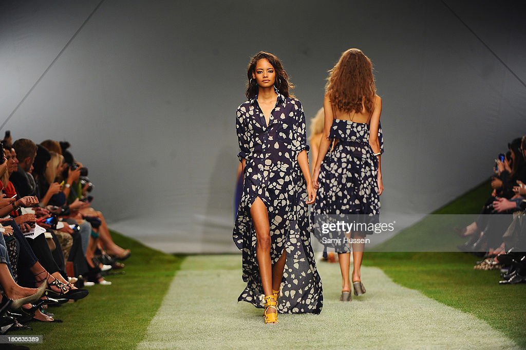 Models walk the runway at the Unique show during London Fashion Week SS14 at TopShop Show Space on September 15, 2013 in London, England.