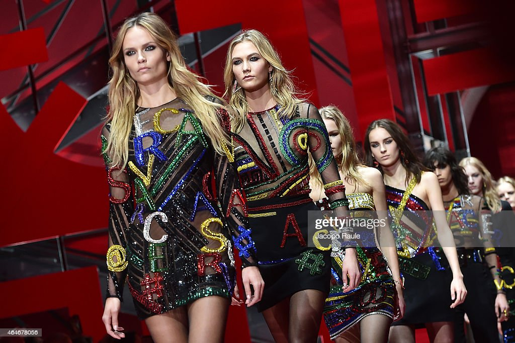 Models walk the runway at the Versace show during the Milan Fashion Week Autumn/Winter 2015 on February 27 2015 in Milan Italy