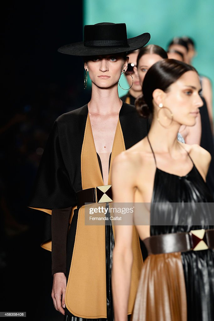 Models walk the runway at the Victor Dzenk fashion show during Sao Paulo Fashion Week Winter 2015 at Parque Candido Portinari on November 3 2014 in...