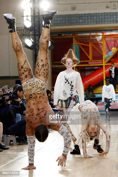 Models walk the runway at the Vivenne Westwood show during the London Fashion Week Men's June 2017 collections on June 12 2017 in London England