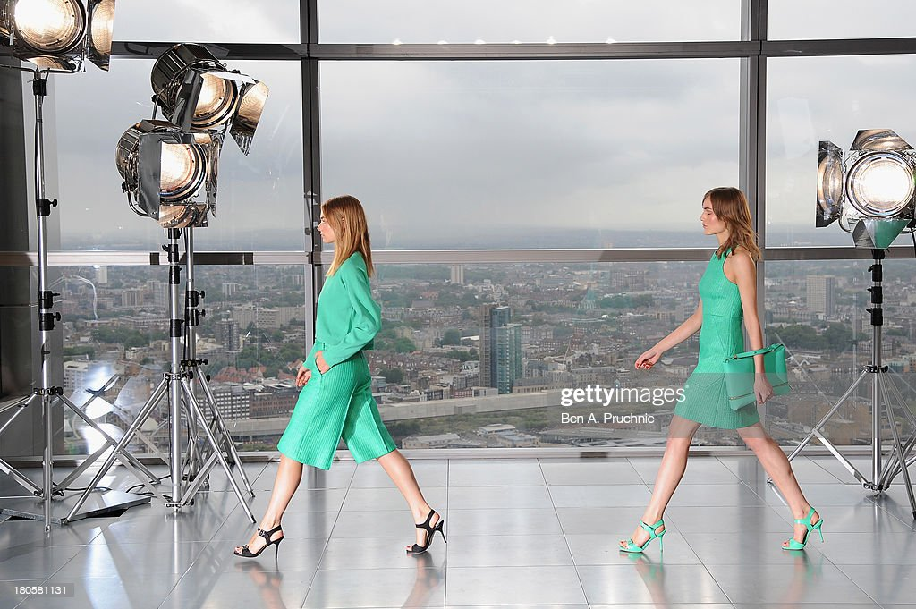 Models walk the runway at the Whistles show during London Fashion Week SS14 at Heron Tower on September 14 2013 in London England