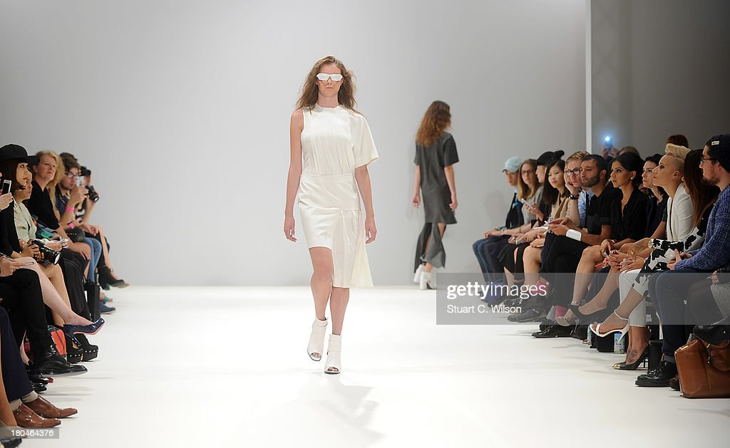 Models walk the runway at the Yifang Wan show during at the Fashion Scout venue during London Fashion Week SS14 at Freemasons Hall on September 13, 2013 in London, England.