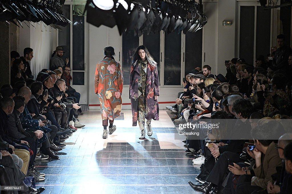 Models walk the runway at the Yohji Yamamoto Autumn Winter 2014 fashion show during Paris Menswear Fashion Week on January 16, 2014 in Paris, France.
