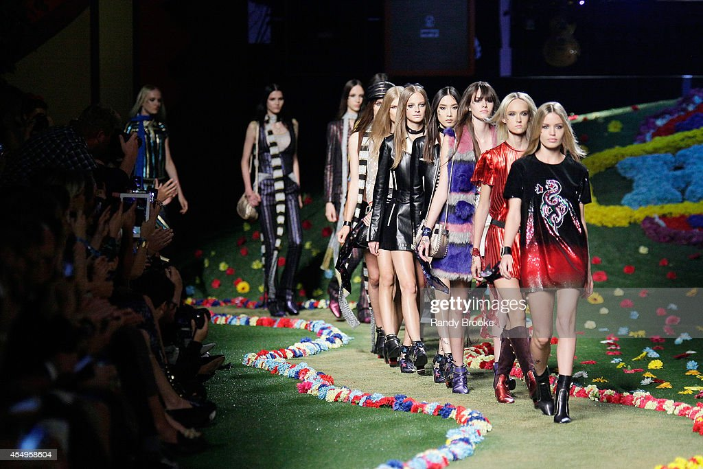 Models walk the runway at Tommy Hilfiger Women's fashion show during MercedesBenz Fashion Week Spring 2015 at Park Avenue Armory on September 8 2014...