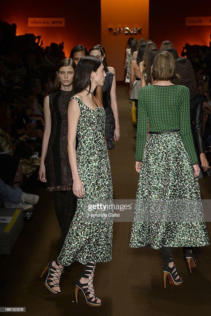 Models walk the runway at Tufi Duek show at Sao Paulo Fashion Week Winter 2014 on October 28, 2013 in Sao Paulo, Brazil.