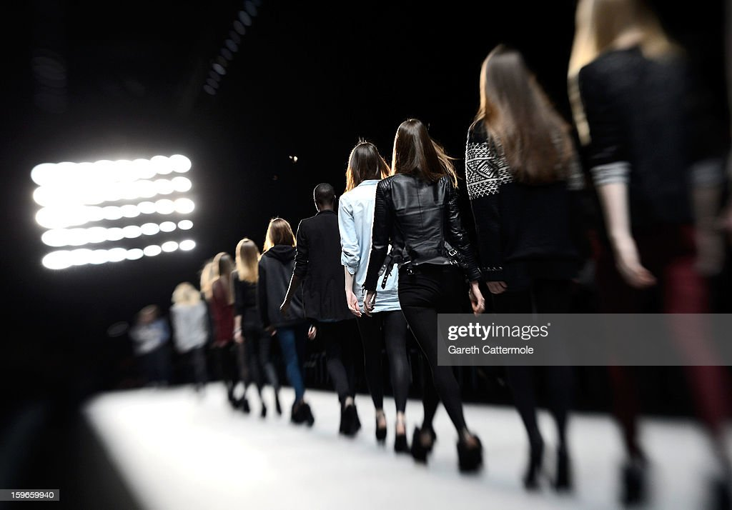 Models walk the runway before the Irina Schrotter Autumn/Winter 2013/14 fashion show during Mercedes-Benz Fashion Week Berlin at Brandenburg Gate on January 18, 2013 in Berlin, Germany.
