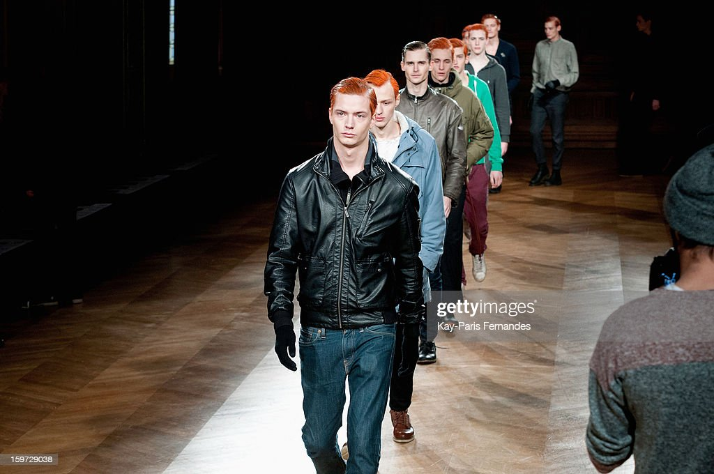 Models walk the runway before the Songzio Men Autumn / Winter 2013 show as part of Paris Fashion Week on January 19, 2013 in Paris, France.