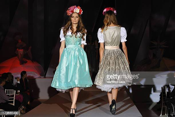 Models walk the runway during a Sportalm fashion show held during their 60th anniversary celebration at Bichelalm on July 12 2013 in Kitzbuehel...