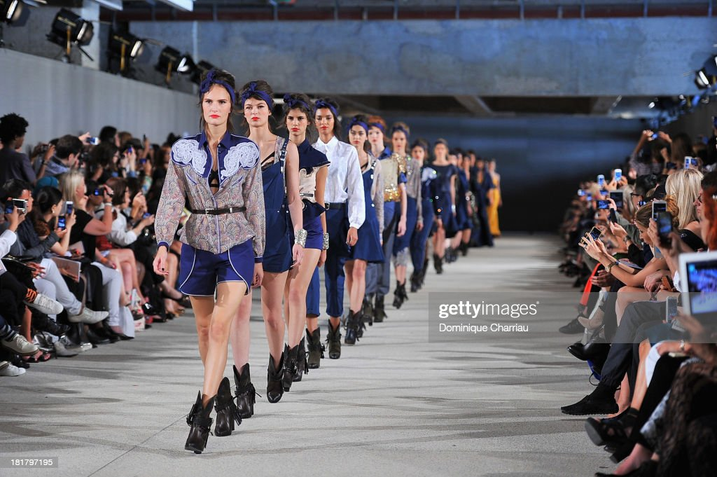 Models walk the runway during Alexis Mabille show as part of the Paris Fashion Week Womenswear Spring/Summer 2014 on September 25, 2013 in Paris, France.