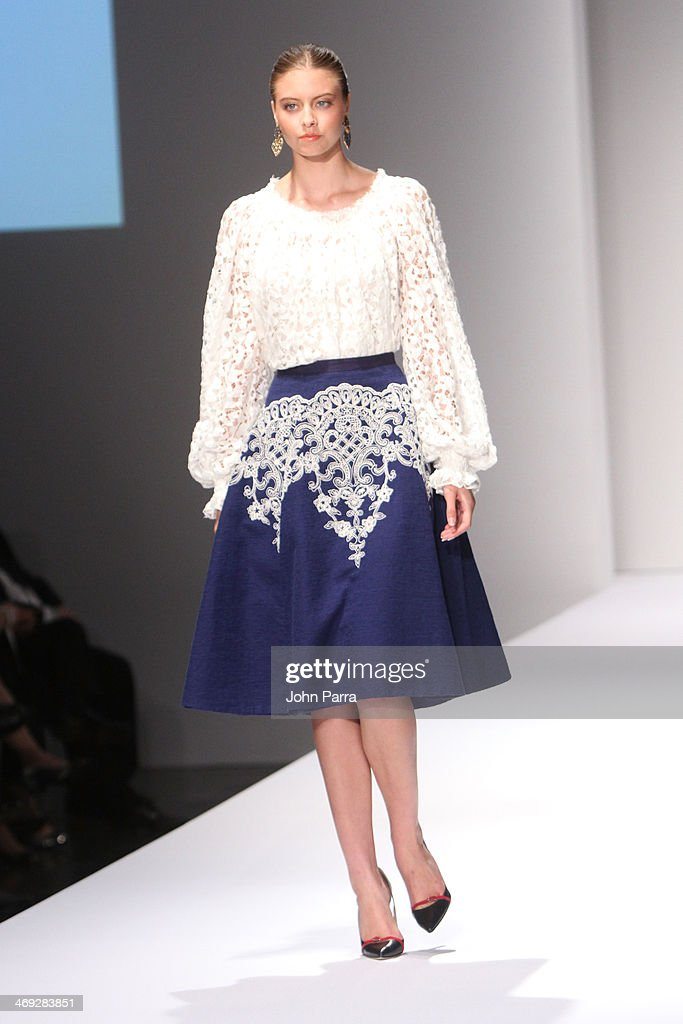 Models walk the runway during an Oscar de la Renta fashion show during the Designed For A Cure 2014 Benefiting Sylvester Comprehensive Cancer Center on February 13, 2014 in Miami, Florida.