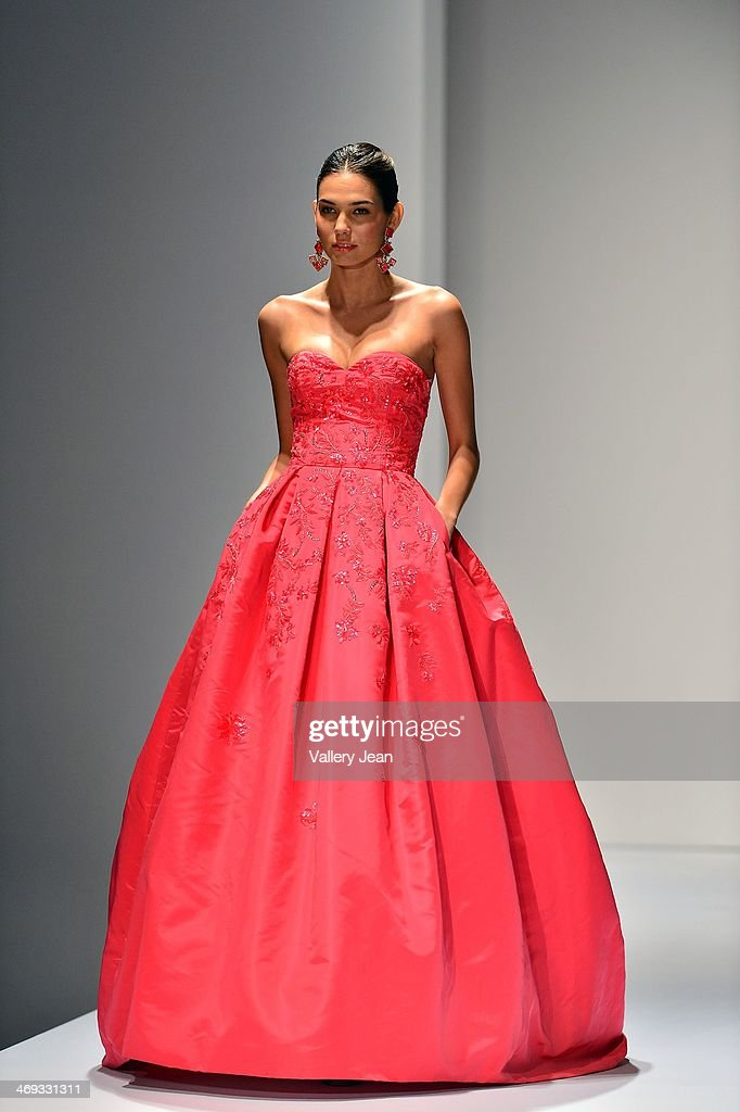 Models walk the runway during an Oscar de la Renta fashion show during the Designed For A Cure 2014 Benefiting Sylvester Comprehensive Cancer Center...