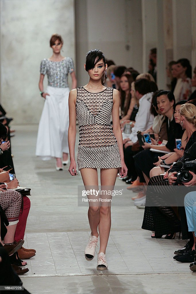 Models walk the runway during Chanel Cruise 2013/14 Collection show on May 9, 2013 in Singapore.