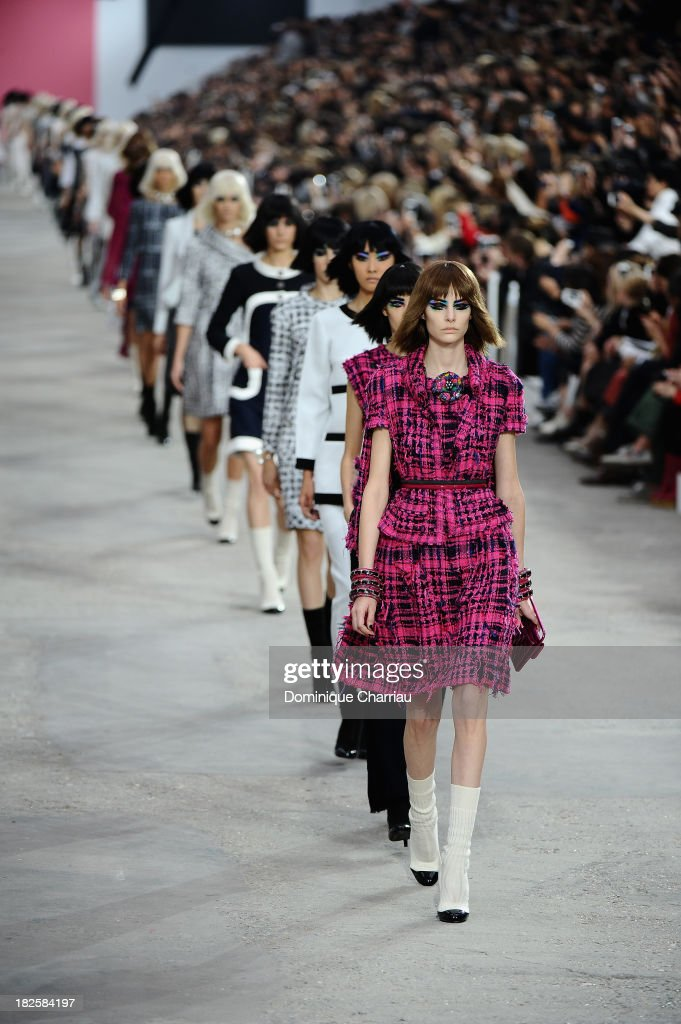 Models walk the runway during Chanel show as part of the Paris Fashion Week Womenswear Spring/Summer 2014 on October 1, 2013 in Paris, France.