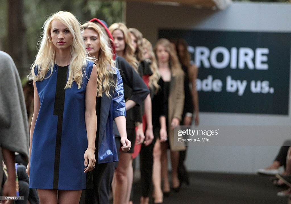 A models walk the runway during Croire .made by us. F/W 2013 colletion fashion show at Casina del Lago Villa Borghese on July 4, 2013 in Rome, Italy.