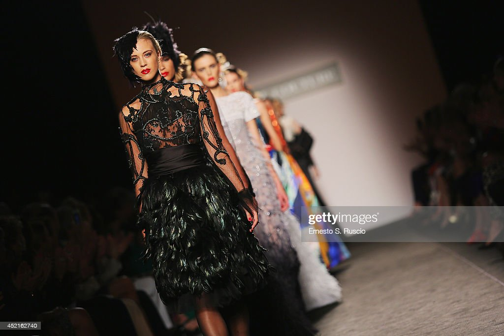 Models walk the runway during Curiel Couture F/W 2014-2015 Italian Haute Couture colletion fashion show as part of AltaRoma AltaModa Fashion Week at Santo Spirito In Sassia on July 14, 2014 in Rome, Italy.