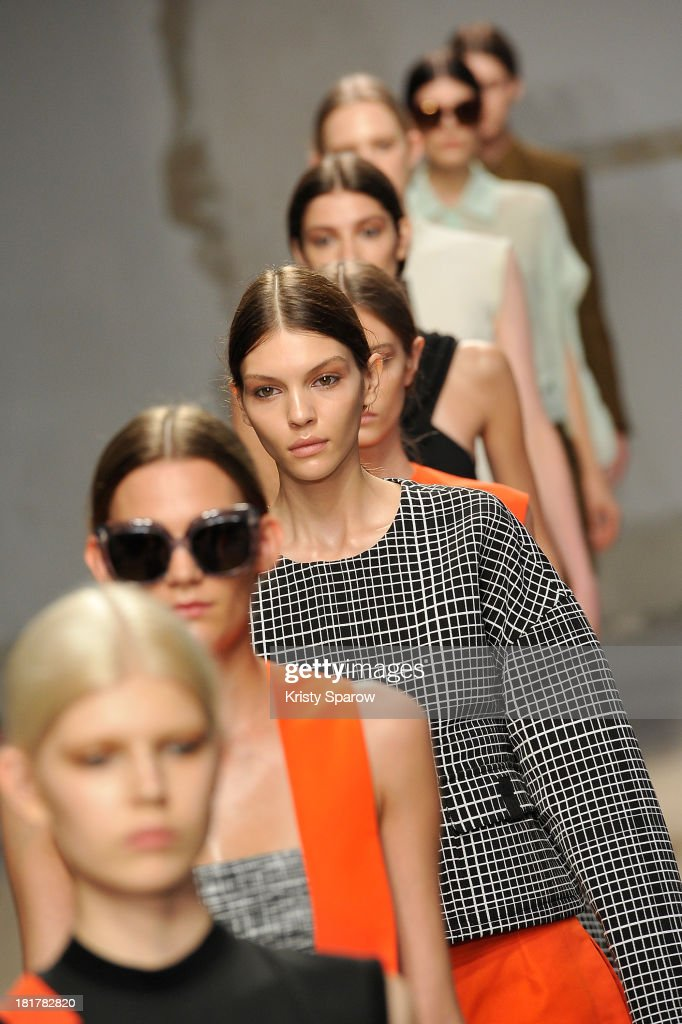 Models walk the runway during Damir Doma show as part of the Paris Fashion Week Womenswear Spring/Summer 2014 on September 25, 2013 in Paris, France.