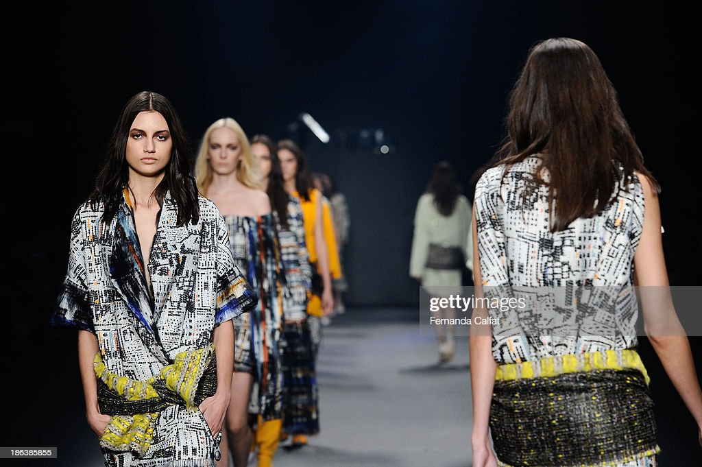 Models walk the runway during Forum show at Sao Paulo Fashion Week Winter 2014>> on October 30, 2013 in Sao Paulo, Brazil.