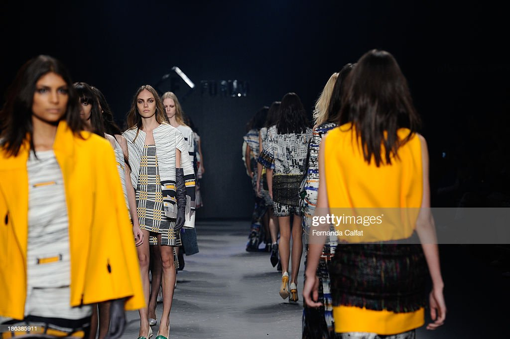 Models walk the runway during Forum show at Sao Paulo Fashion Week Winter 2014 on October 30, 2013 in Sao Paulo, Brazil.