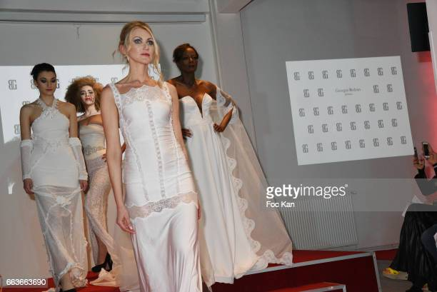Models walk the runway during Georges Bedran Fashion Show at Espace Batignolles on April 1 2017 in Paris France
