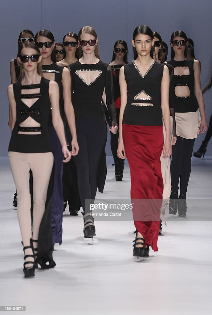 Models walk the runway during Gloria Coelho show at Sao Paulo Fashion Week Winter 2014 on October 31, 2013 in Sao Paulo, Brazil.