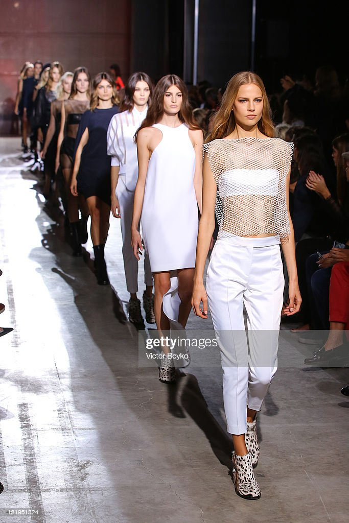 Models walk the runway during IRFE show as part of the Paris Fashion Week Womenswear Spring/Summer 2014 on September 26, 2013 in Paris, France.