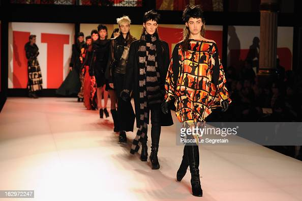 Models walk the runway during Jean Paul Gaultier Fall/Winter 2013 ReadytoWear show as part of Paris Fashion Week on March 2 2013 in Paris France