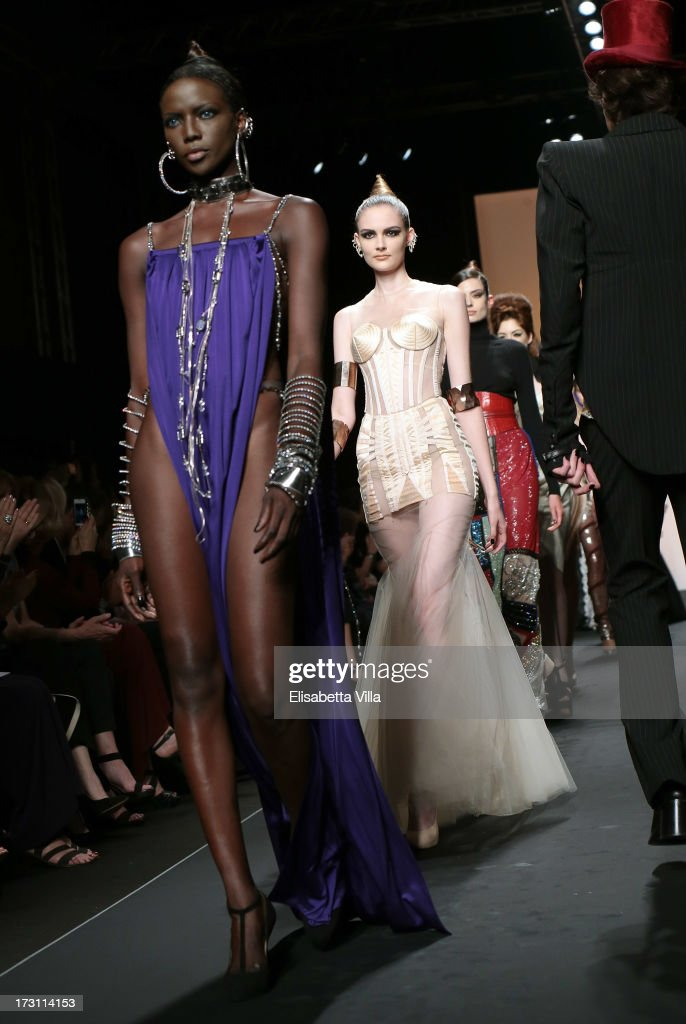 Models walk the runway during Jean Paul Gaultier Houte Couture Paris fashion show as part of AltaRoma AltaModa Fashion Week at Santo Spirito in Sassia on July 7, 2013 in Rome, Italy.