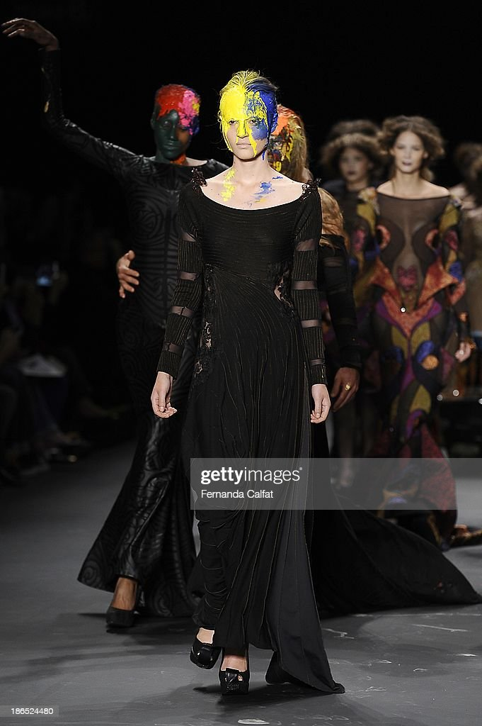 Models walk the runway during Lino Villaventura show at Sao Paulo Fashion Week Winter 2014 on October 31, 2013 in Sao Paulo, Brazil.