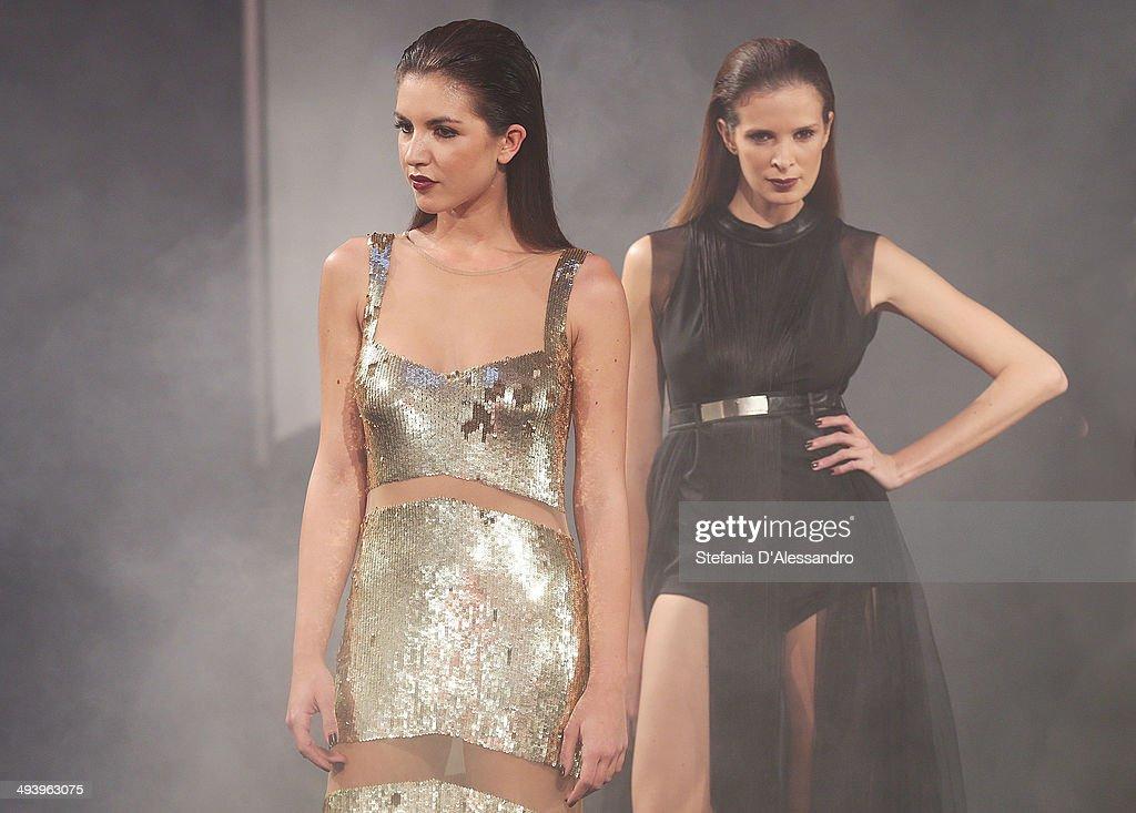 Models walk the runway during Mangano Fashion Show on May 26, 2014 in Milan, Italy.