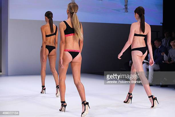 Models walk the runway during MercedesBenz Fashion Festival Sydney at Town Hall on September 24 2014 in Sydney Australia
