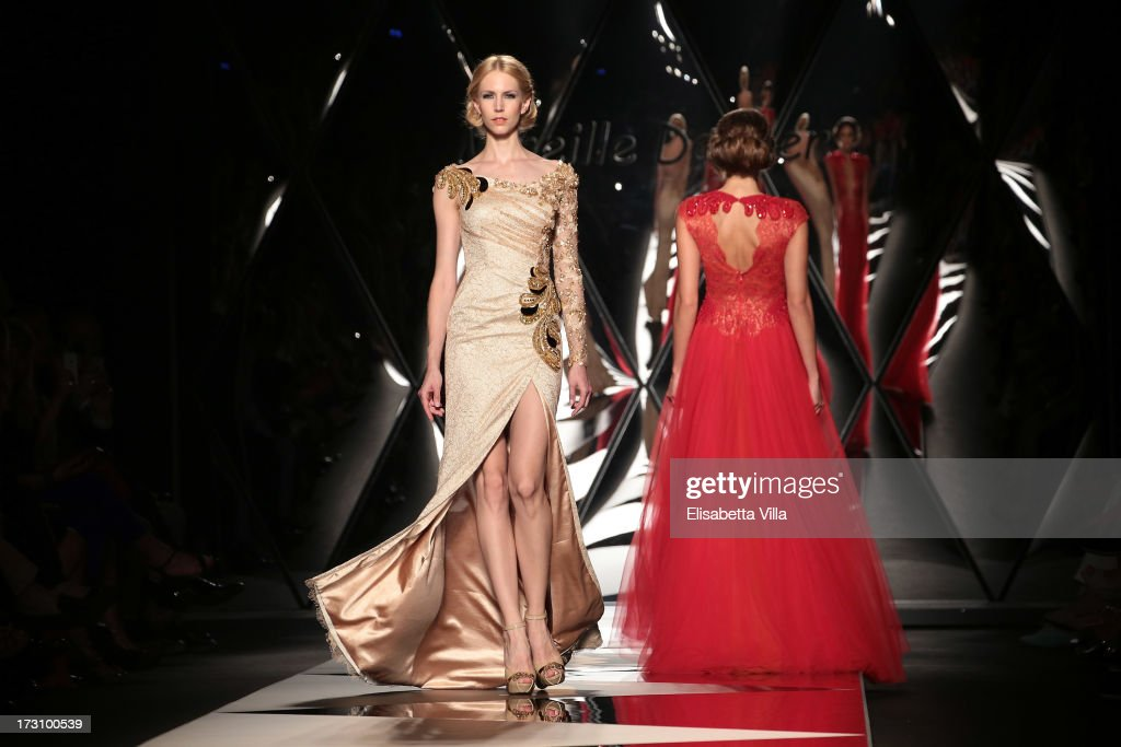 Models walk the runway during Mireille Dagher F/W 2013-2014 Haute Couture Colletion fashion show as part of AltaRoma AltaModa Fashion Week at Santo Spirito In Sassia on July 6, 2013 in Rome, Italy.