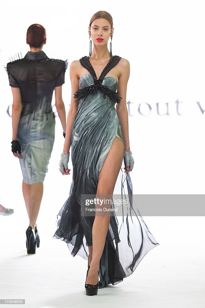Models walk the runway during On Aura Tout Vu show as part of Paris Fashion Week Haute-Couture Fall/Winter 2013-2014 at on July 1, 2013 in Paris, France.