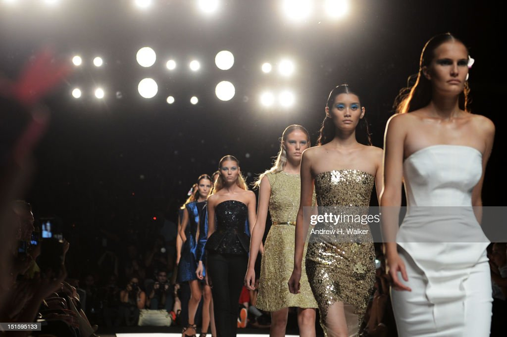 Models walk the runway during Spring 2013 Mercedes-Benz Fashion Week at Lincoln Center for the Performing Arts on September 8, 2012 in New York City.