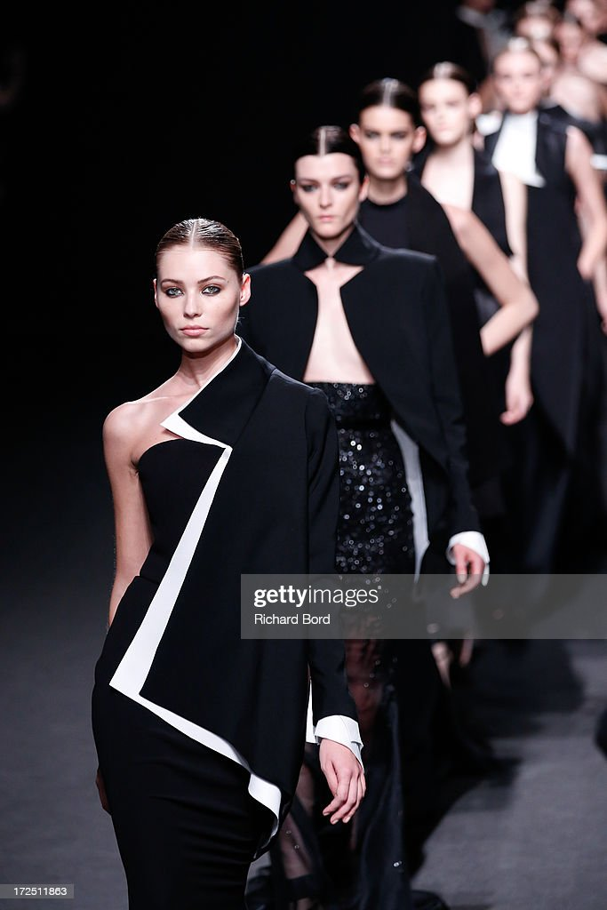 Models walk the runway during Stephane Rolland show as part of Paris Fashion Week Haute-Couture Fall/Winter 2013-2014 at Tennis Club de Paris on July 2, 2013 in Paris, France.
