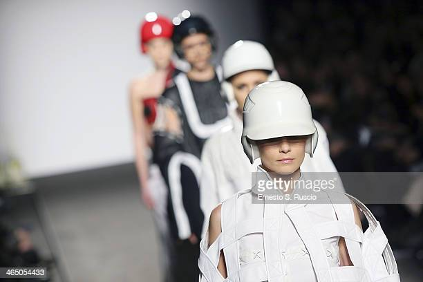 Models walk the runway during the Accademia Costume Moda fashion show as part of AltaRoma Fashion Week Spring/Summer 2014 on January 25 2014 in Rome...