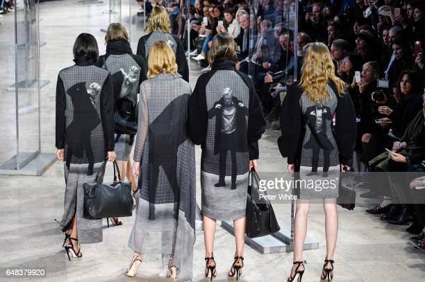 Models walk the runway during the Akris show as part of the Paris Fashion Week Womenswear Fall/Winter 2017/2018 on March 5 2017 in Paris France