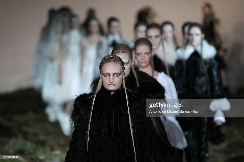 Models walk the runway during the Alexander McQueen show as part of the Paris Fashion Week Womenswear Fall/Winter 2014-2015 on March 4, 2014 in Paris, France.