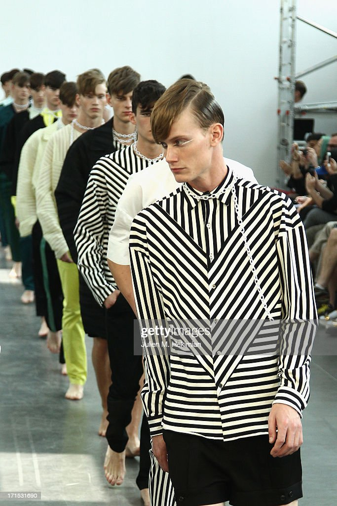 Models walk the runway during the Alibellus + Menswear Spring/Summer 2014 show as part of the Paris Fashion Week on June 26, 2013 in Paris, France.