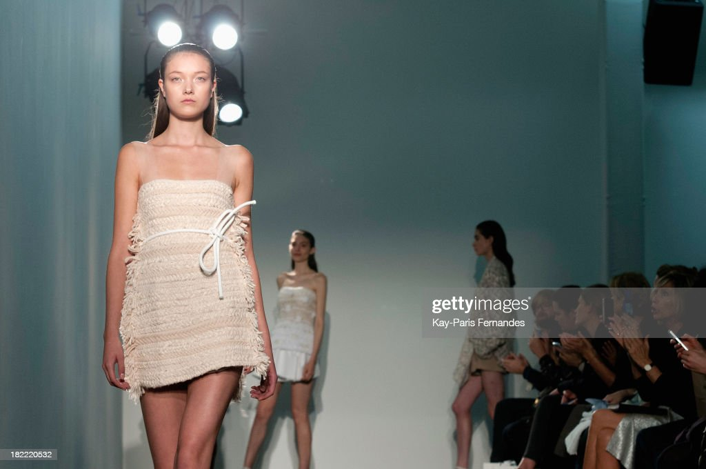 Models walk the runway during the Allude show as part of the Paris Fashion Week Womenswear Spring/Summer 2014 at the Jeu de Paume on September 28, 2013 in Paris, France.