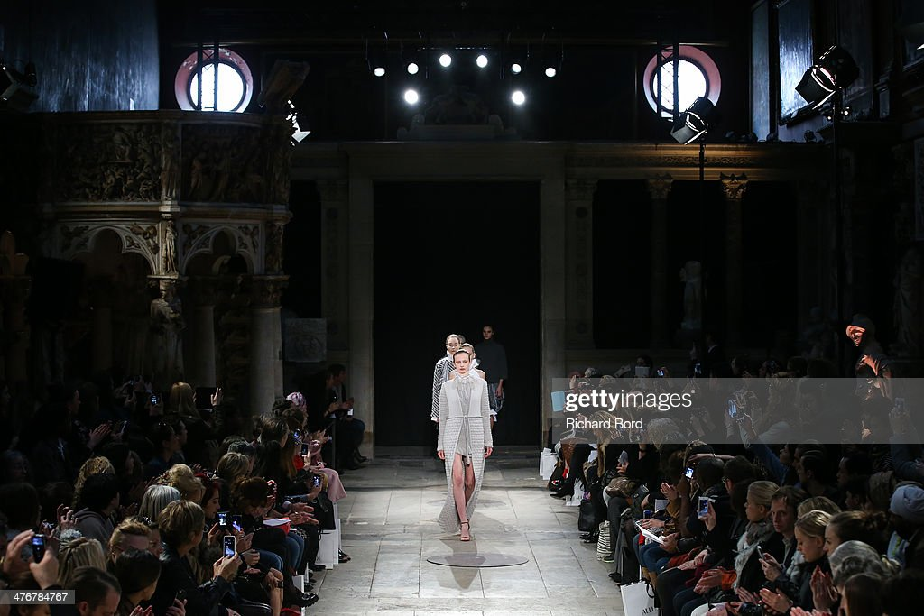 Models walk the runway during the Allude show as part of the Paris Fashion Week Womenswear Fall/Winter 2014-2015 at Chapelle des Beaux Arts on March 5, 2014 in Paris, France.