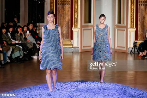 Models walk the runway during the Anrealage show at Westin Hotel as part of the Paris Fashion Week Womenswear Fall/Winter 2017/2018 on February 28...