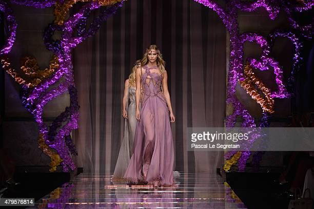 Models walk the runway during the Atelier Versace show as part of Paris Fashion Week Haute Couture Fall/Winter 2015/2016 on July 5 2015 in Paris...