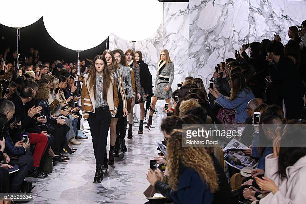 Models walk the runway during the Carven show as part of the Paris Fashion Week Womenswear Fall/Winter 2016/2017 on March 3 2016 in Paris France