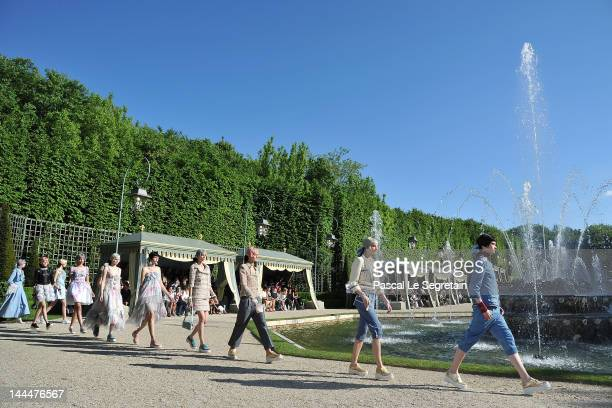 Models walk the runway during the Chanel 2012/13 Cruise Collection at Chateau de Versailles on May 14 2012 in Versailles France
