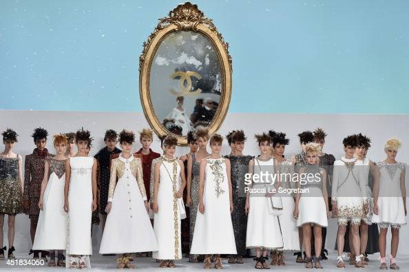 Models walk the runway during the Chanel show as part of Paris Fashion Week Haute Couture Fall/Winter 20142015 at Grand Palais on July 8 2014 in...