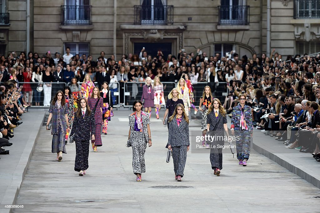Models walk the runway during the Chanel show as part of the Paris Fashion Week Womenswear Spring/Summer 2015 on September 30, 2014 in Paris, France.