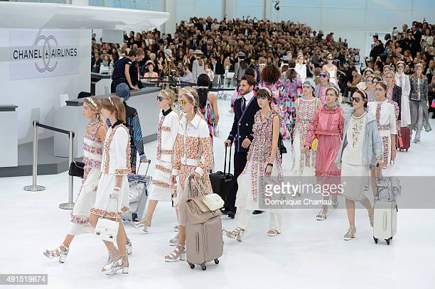 Models walk the runway during the Chanel show as part of the Paris Fashion Week Womenswear Spring/Summer 2016 on October 6 2015 in Paris France