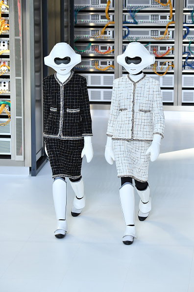 Models walk the runway during the Chanel show as part of the Paris Fashion Week Womenswear Spring/Summer 2017 on October 4 2016 in Paris France