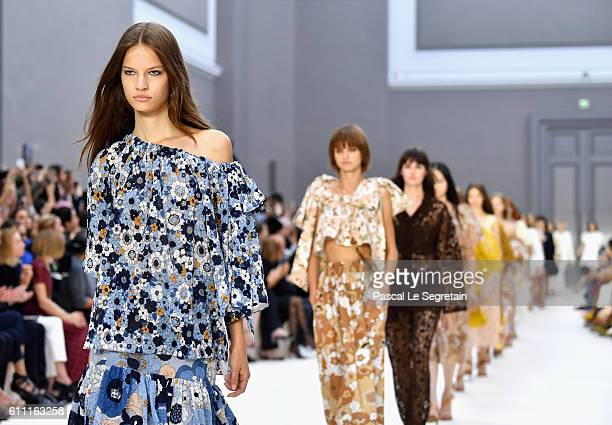Models walk the runway during the Chloe show as part of the Paris Fashion Week Womenswear Spring/Summer 2017 on September 29 2016 in Paris France